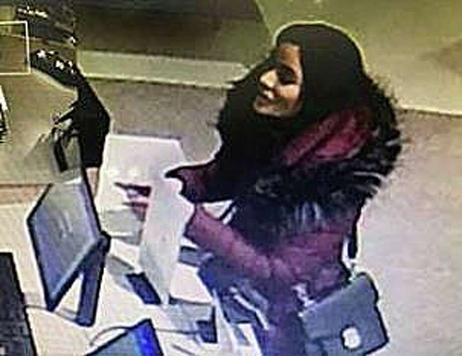 New Canaan police are looking for this woman who used stolen credit cards to go on a more than $12,000 spending spree at Norwalk's new mall. On Wednesday, Dec. 4, 2019, police posted on Facebook photos of the woman enjoying her day at The SoNo Collection mall. Police said the woman used the stolen cards during the shopping binge on Thursday, Nov. 14, 2019. Photo: New Canaan Police Photo