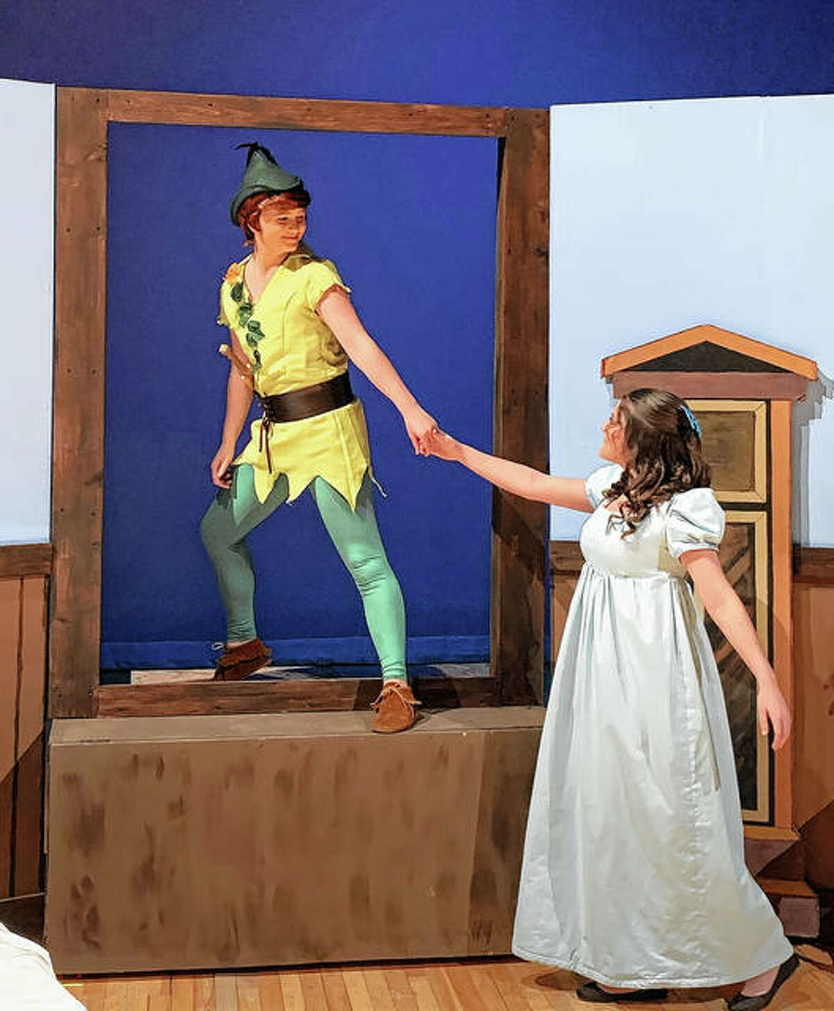"""Kyla Pattie (left) as Peter Pan and Amiah Mather as Wendy Darling rehearse a scene from the Jacksonville High School theater department's production of """"Peter Pan"""". The play will be presented at 7:30 p.m. Friday, Saturday and Sunday in the JHS auditorium. Tickets are $5 at the door."""