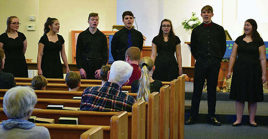 The Jacksonville High School Madrigal Singers perform Wednesday during Faith Lutheran Church's first Advent Allegro concert. Advent, which continues through Dec. 24, is a time of waiting and preparation for Christmas. Photo: Marco Cartolano | Journal-Courier