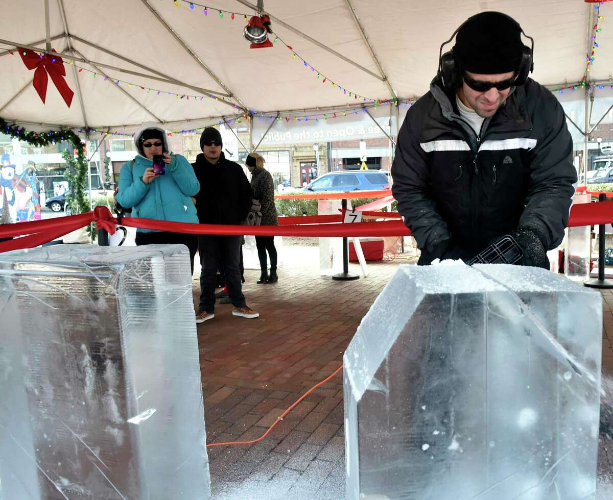 Jared Welcome of Hamden a woodcarver, tries his hand at ice carving as he competed in The Shops at Yale sponsored Ice Carving competition Dec. 8, 2018 on the Broadway Island on Broadway in New Haven. Eight professional ice carvers attempted to transform 900-pounds of ice into a sculpture in 4-hours.