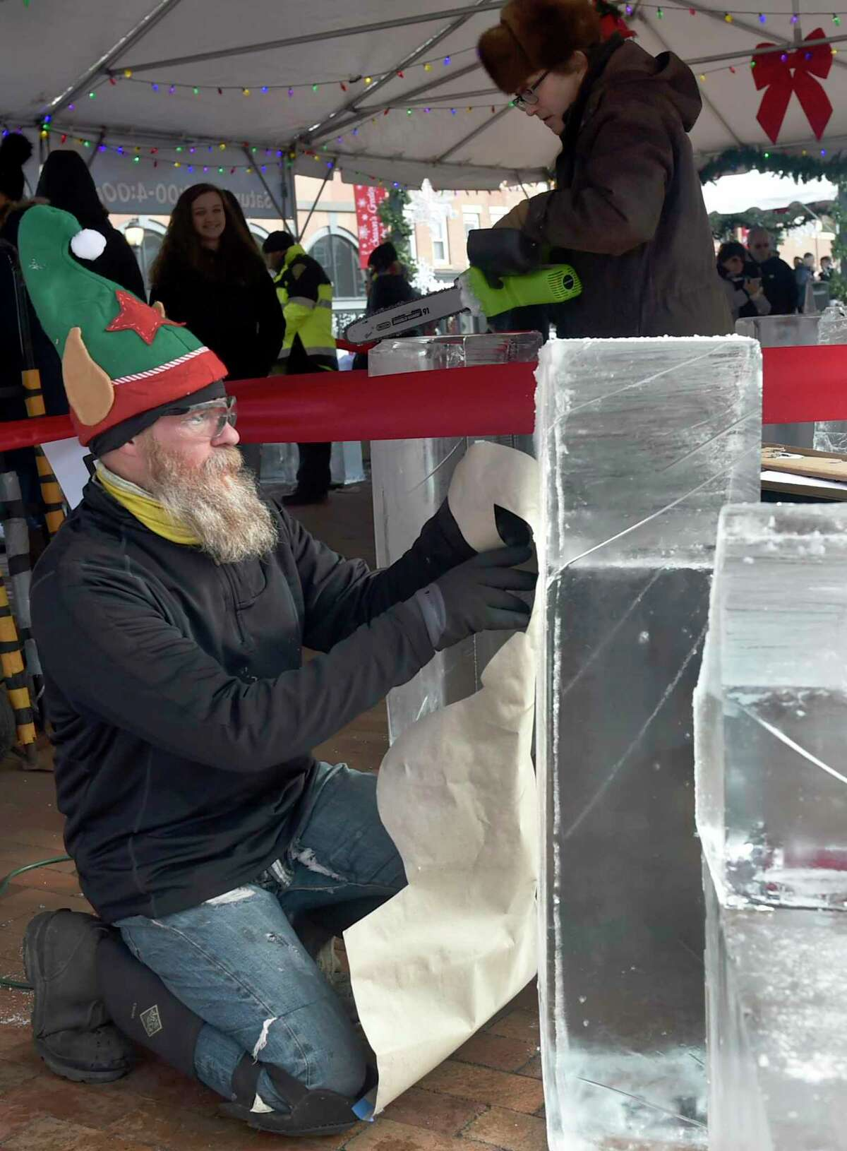 Part-time professional ice carver Joseph Bywater of Highland, N.Y. begins his ice carving design as he competes in The Shops at Yale sponsored Ice Carving competition Dec. 8, 2018 on the Broadway Island on Broadway in New Haven.