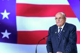 Former New York City Mayor Rudy Giuliani speaks during a conference in Manza, Albania.