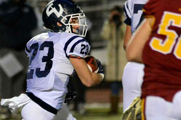 Jack DiRocco carries the ball during Wilton's loss to St. Joseph in the Class L quarterfinals Wednesday night.