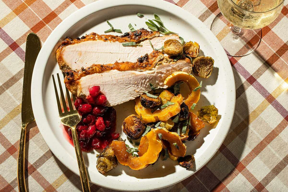 Herbed Turkey Breast With Delicata Squash and Brussels Sprouts.