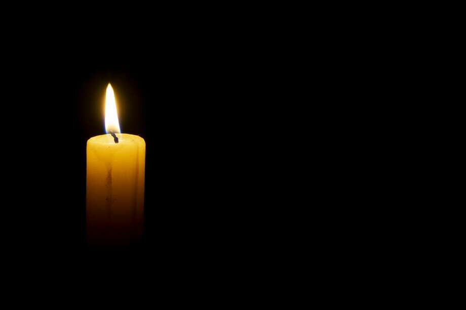 burning wax candle on a black background Photo: Axeiz77/Getty Images/iStockphoto