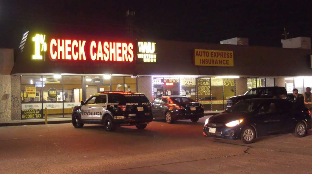 Houston police officers investigate an attempted robbery at a check cashing store in the 11100 block of Briar Forest Drive on Wednesday, Dec. 4, 2019.