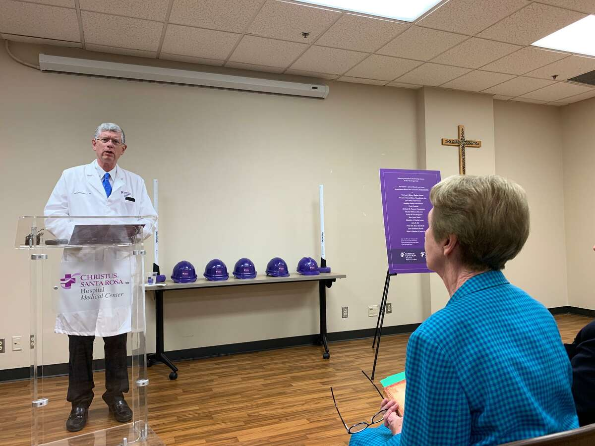 Dr. Ian M. Thompson, Jr., president of Christus Santa Rosa Hospital - Medical Center, talks about the holistic approach they plan to take at the new oncology unit, which is expected to open next summer. Sister Rosita Hyland sits in the audience at the groundbreaking ceremony on Dec. 4 after she led the group in a blessing.