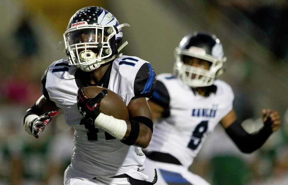 New Caney running back Cale Sanders, Jr. (11) runs for a 7-yard touchdown during the second quarter of a District 9-5A (Div. 1) high school football game at Turner Stadium, Saturday, Oct. 19, 2019, in Humble. Photo: Jason Fochtman, Houston Chronicle / Staff Photographer / Houston Chronicle