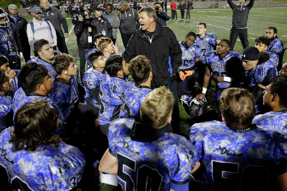 New Caney head coach Brady Pennington, center, talks with his players after defeating Porter in their District 9-5A high school football game late last season. Photo: Michael Wyke / Contributor / © 2019 Houston Chronicle
