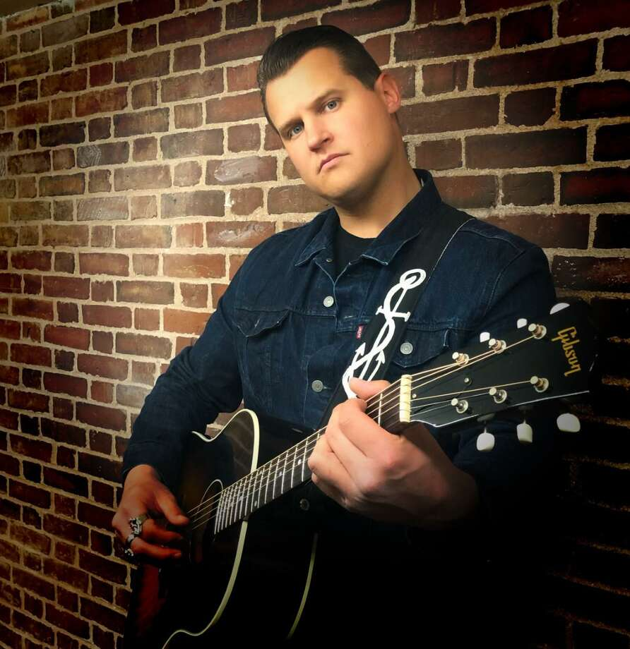 Joey Wit & The Definition will take the stage Friday night at Cafe 9 in New Haven for a performance that will benefit Toys for Tots. Joey Witkowski, the rock and roll band's leader, is a Middletown native who graduated from Xavier High School. Photo: Contributed Photo