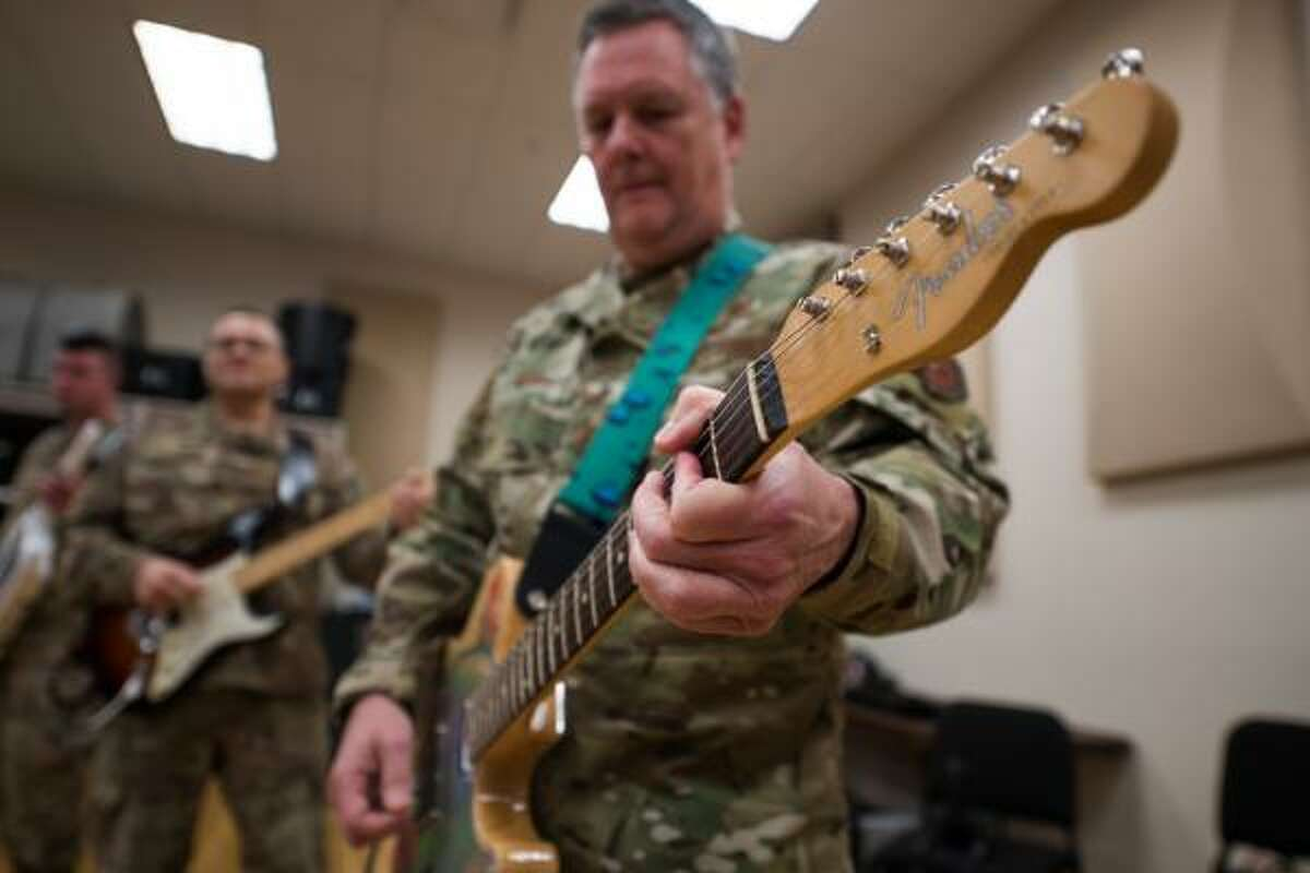 Lt. Gen. Brad Webb, commander of Air Education and Training Command at center, rehearses with members of the Air Force Band of the West at Joint Base San Antonio-Lackland on Nov. 26. The general will play guitar with the band during its Holiday in Blue concerts this weekend at the Edgewood ISD performing arts center.