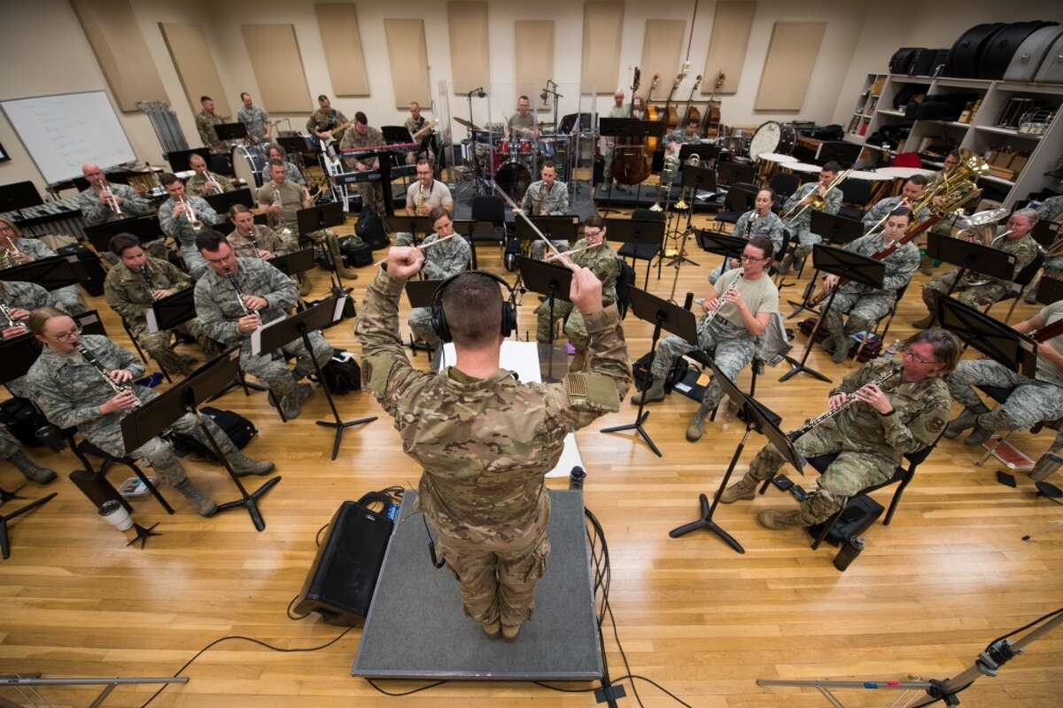 Major Dustin Doyle, U.S. Air Force Band of the West commander and conductor, directs his band during a rehearsal, Nov. 26, 2019, at Joint Base San Antonio-Lackland. Lt. Gen. Brad Webb, commander of Air Education and Training Command, will play guitar with the band during its Holiday in Blue concerts this weekend at the Edgewood ISD performing arts center.