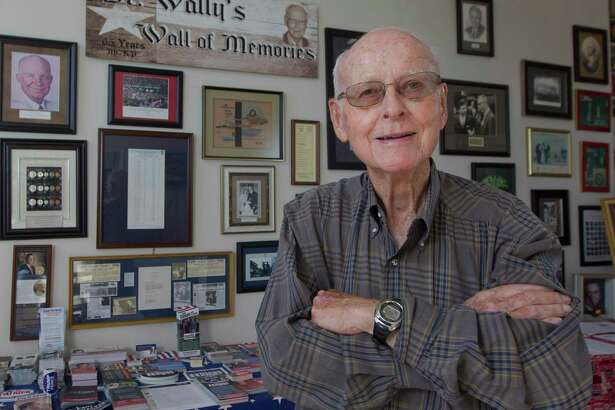 Montgomery County Republican Party Chairman Wally Wilkerson poses for a portrait in front of his wall of memories from more than 50 years as chairman at the Montgomery County Republican Headquarters in 2018. Wilkeron's historic term came to an end on Aug. 3.