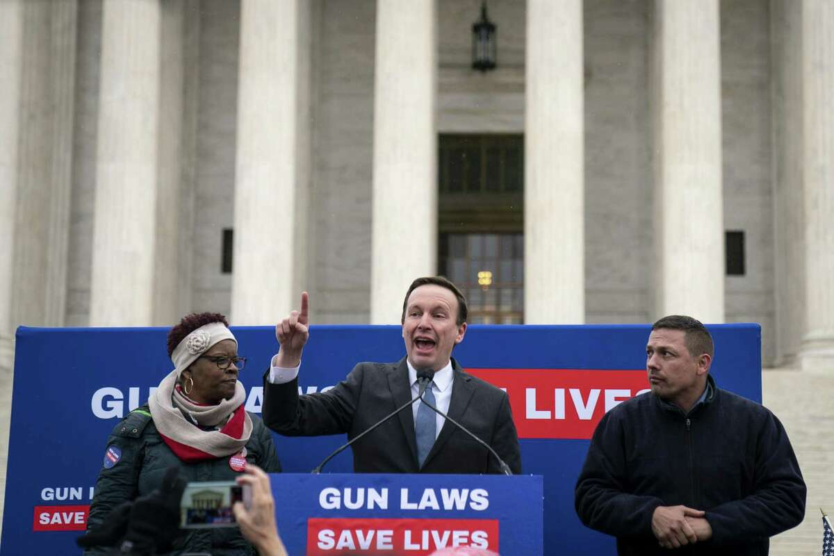 Brenda Moss, who lost her son to gun violence, looks on as U.S. Sen. Chris Murphy speaks to gun safety advocates as they rally in front of the U.S. Supreme Court during oral arguments in the Second Amendment case NY State Rifle & Pistol v. City of New York, NY on Monday in Washington, D.C.