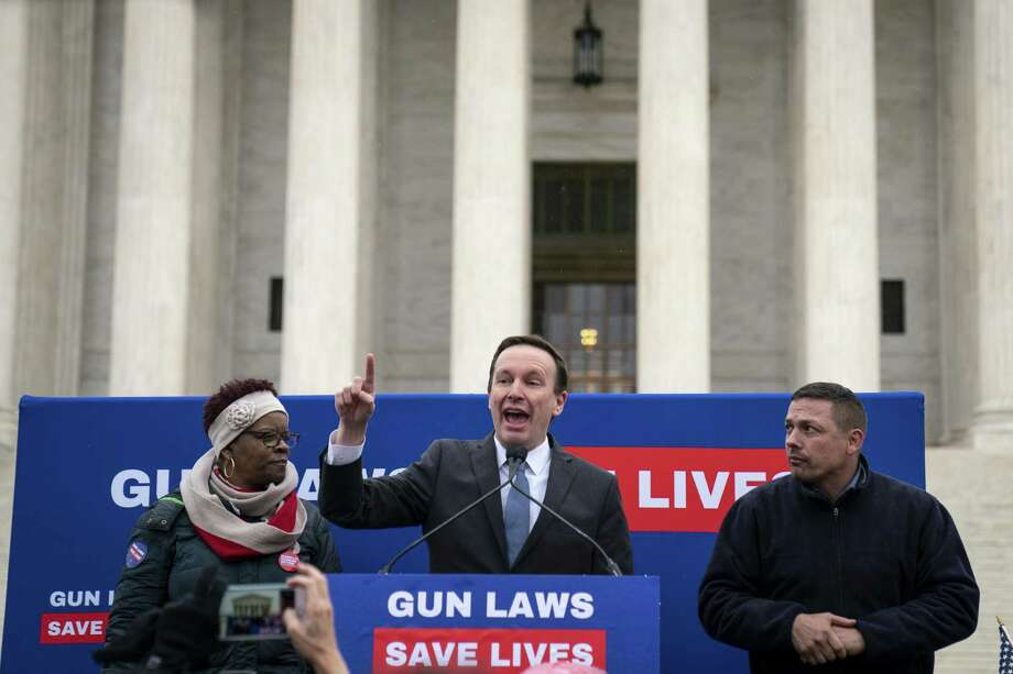 Brenda Moss, who lost her son to gun violence, looks on as U.S. Sen. Chris Murphy speaks to gun safety advocates as they rally in front of the U.S. Supreme Court during oral arguments in the Second Amendment case NY State Rifle & Pistol v. City of New York, NY on Monday in Washington, D.C. Photo: Getty Images / 2019 Getty Images