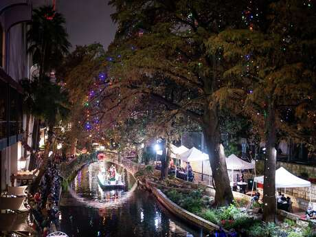 The first float makes its way through the Ford Holiday River Parade on the Riverwalk in downtown San Antonio, Texas on Friday, November 29, 2019.