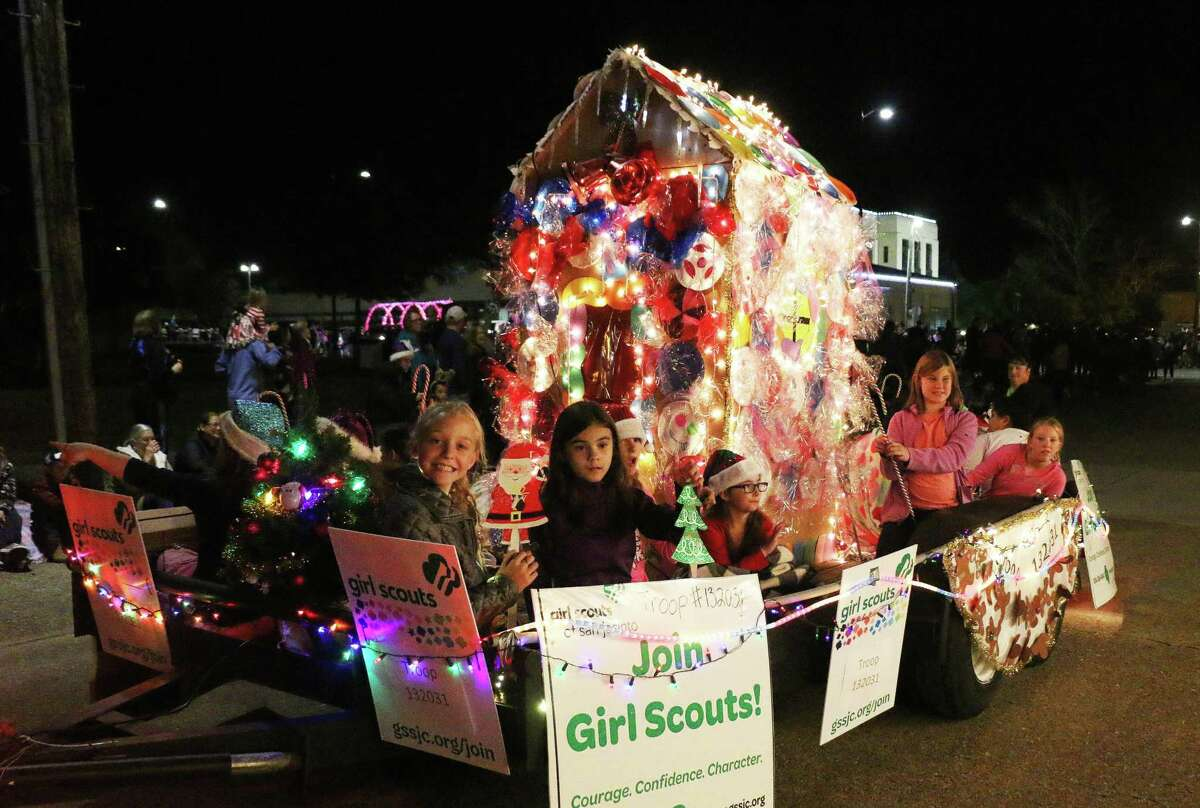 The Girl Scouts Troop 132031 from Hardin road in with a delicious-looking gingerbread house completely covered with lots of candy.