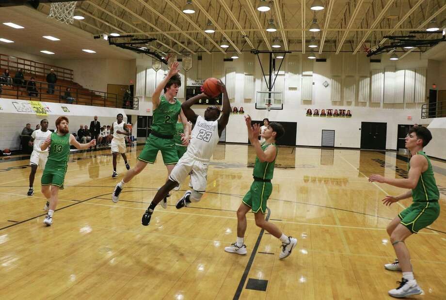 Johnny Harris-Hines outjumps his Bear opponent for a field goal in the Liberty win over Little Cypress-Mauriceville at The Lair Tuesday night. Photo: David Taylor / Staff Photo