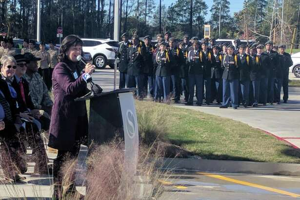 Spring ISD officials and residents gather Wednesday for the opening of Spring ISD's new veterans memorial outside Planet Ford Stadium, 23802 Cypresswood Drive.