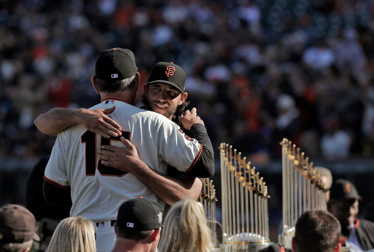 Giants pitcher Madison Bumgarner hugs Bruce Bochy during a ceremony honoring Bochy after he managed his final game with the San Francisco Giants at Oracle Park in San Francisco, Calif., on Sunday, September 29, 2019.
