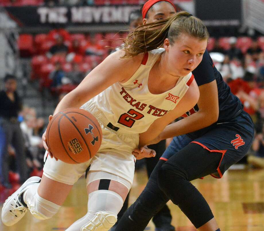 Texas Tech's Sydney Goodson blows by an Ole Miss defender during their Big 12-SEC Challenge women's basketball game on Wednesday in the United Supermarkets Arena. Photo: Nathan Giese/Planview Herald