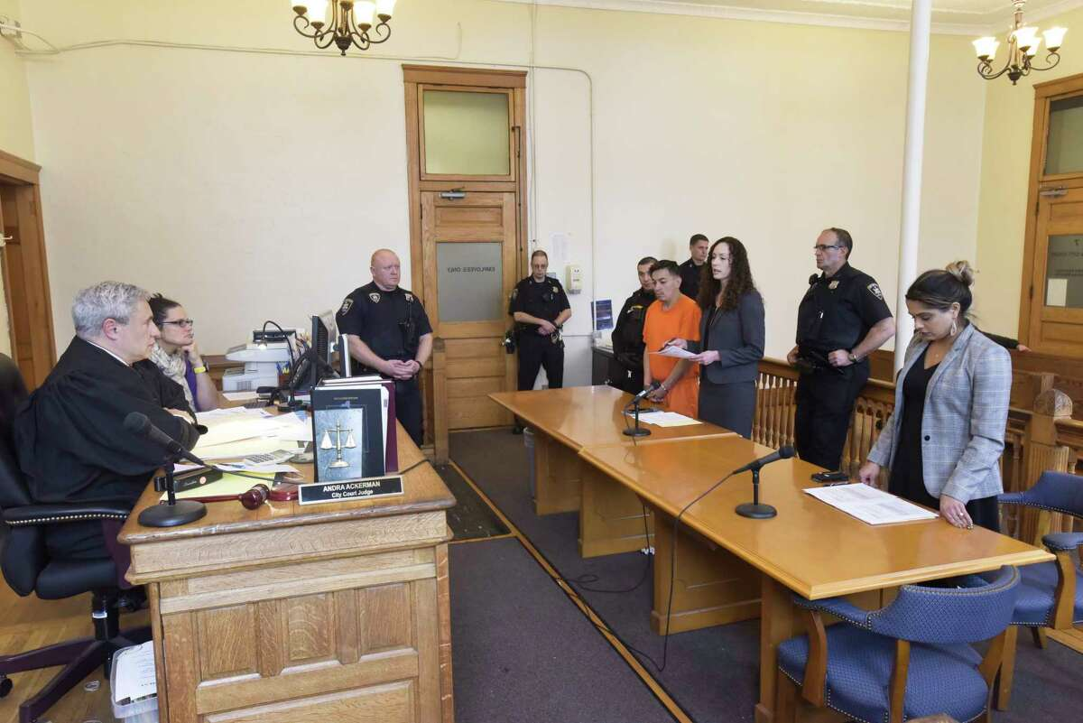Judge Thomas Marcelle, left, holds a bail hearing for Anthony Ojeda, background center, who appears with his attorney, Albany County Assistant Public Defender, Angela Kelley, in Cohoes City Court on Thursday, Dec. 5, 2019, in Albany, N.Y. Also appearing in court is Albany County Assistant D.A., Shanza Malik, far right. (Paul Buckowski/Times Union)