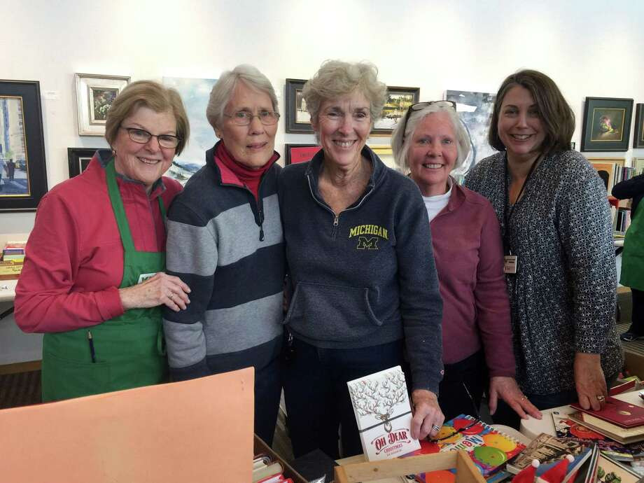 Workers at Wilton Library's holiday book sale, from left, Pat Gould, Jan MacEwan, Maureen Granito, Barbara Quist and Amy Kirk. Photo: Patricia Gay /Hearst Connecticut Media / Wilton Bulletin