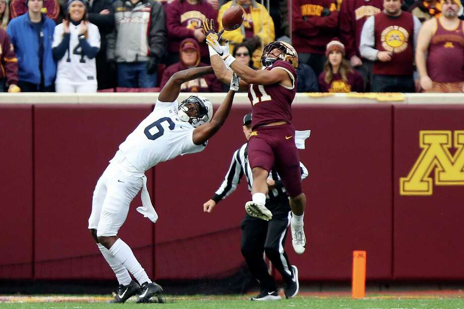 Minnesota defensive back Antoine Winfield Jr. (11) intercepts the ball intended for Penn State wide receiver Justin Shorter (6) during an NCAA college football game, Saturday, Nov. 9, 2019, in Minneapolis. (AP Photo/Stacy Bengs) Photo: Stacy Bengs, FRE / Associated Press / Copyright 2019 The Associated Press. All rights reserved.
