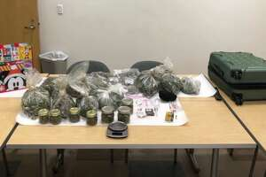 Ten pounds of marijuana, syringes believed to be filled with methamphetamine and an undisclosed amount of LSD were found in a car whose occupants were watching porn, according to Central Marin police. The man and woman in the car were arrested on drug charges. (Tuesday, Dec. 3, 2019.)