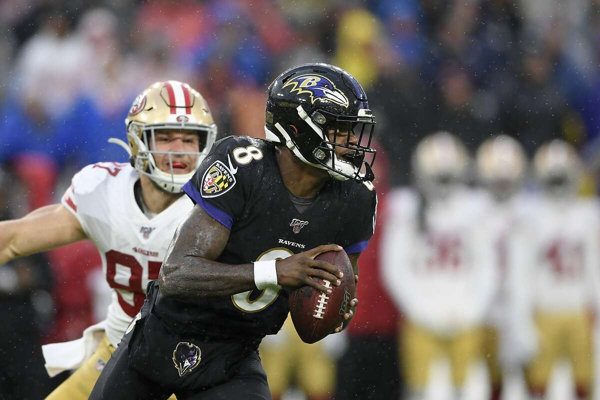 Baltimore Ravens quarterback Lamar Jackson (8) runs with the ball in the first half of an NFL football game against the San Francisco 49ers, Sunday, Dec. 1, 2019, in Baltimore, Md. (AP Photo/Nick Wass)