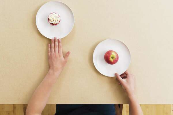 Will you be putting more apples or cupcakes on your plate in 2020? Either way, we want to hear about it. (Getty Images)