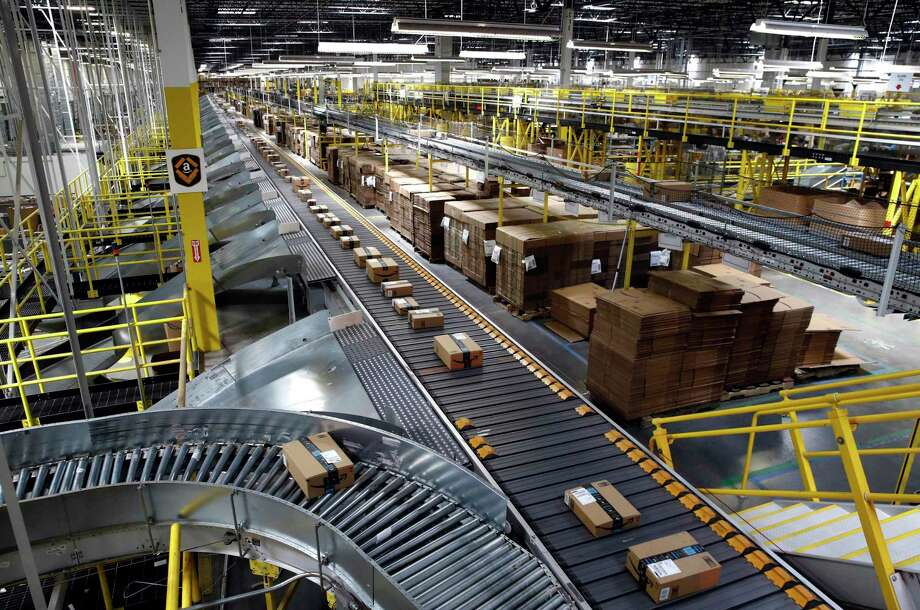 FILE- In this Aug. 3, 2017, file photo, packages ride on a conveyor system at an Amazon fulfillment center in Baltimore. (AP Photo/Patrick Semansky, File) Photo: Patrick Semansky, STF / Associated Press / Copyright 2017 The Associated Press. All rights reserved.