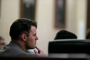 Mark Howerton listens as a witness testifies during his murder trial in San Antonio on Thursday, Dec. 5, 2019.