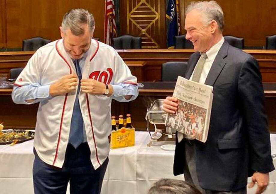 U.S. Sen. Ted Cruz donned a Washington Nationals jersey and served up a feast of barbecue and beer to Sen. Tim Kaine on Thursday.