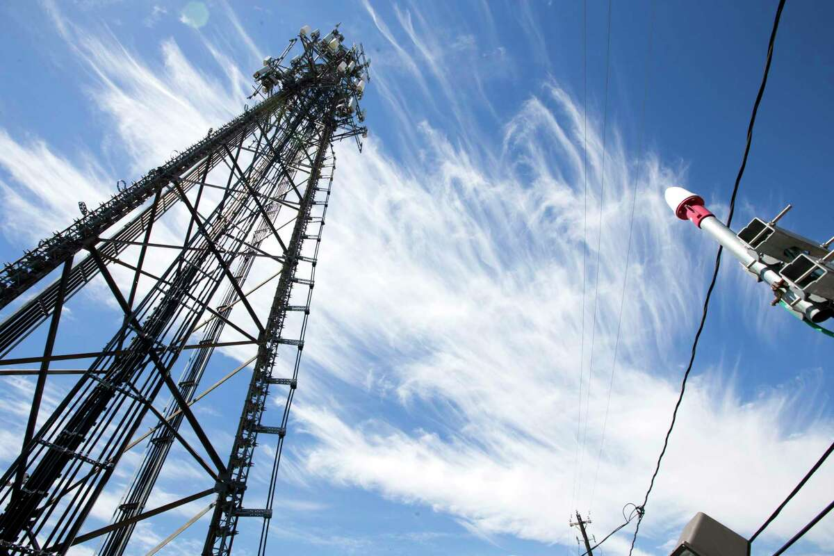 A traditional cell phone tower, owned by Crown Castle, is shown near the Texas Medical Center on Tuesday, Sept. 23, 2014, in Houston. ( Brett Coomer / Houston Chronicle )