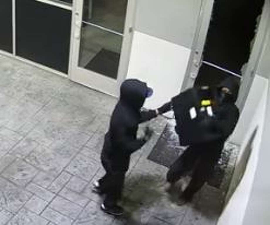 Police are currently searching for two suspects caught on camera breaking into a Planet Ford in Spring. Photo: Harris County Constable Precinct 4