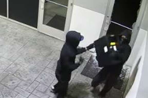 Police are currently searching for two suspects caught on camera breaking into a Planet Ford in Spring.