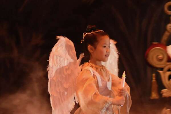 A young costumed angel is seen in the New Haven Ballet production.