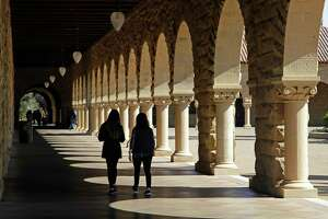 Students walk on the Stanford University campus this spring. Many college students, living with limited funds, have cut back on food. We all should be concerned, but how about getting a part-time job?