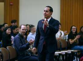 Democratic presidential candidate Julian Castro waves to students as he's introduced for a discussion on international relations and foreign policy at Stanford University, his alma mater, in Stanford, Calif. on Thursday, Dec. 5, 2019.