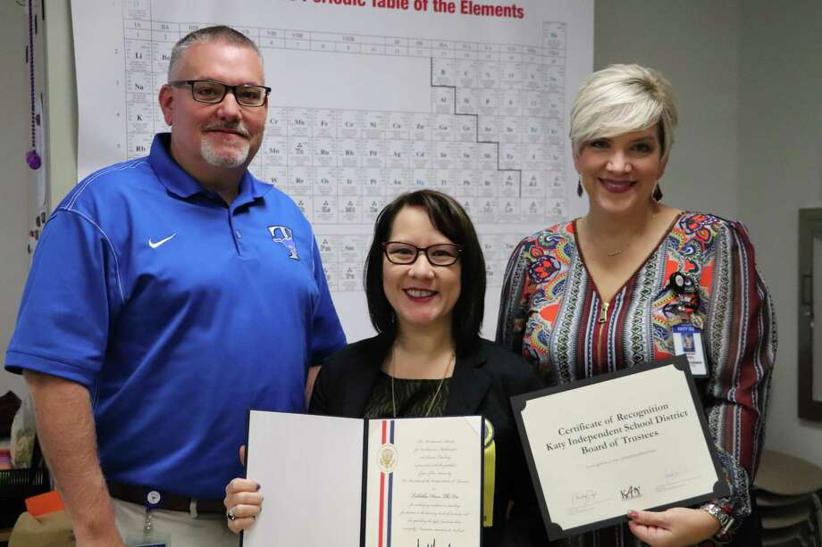 The Katy Independent School District recently presented a certificate of appreciation to Taylor High School teacher Tabitha Vu. From left are Taylor High School Principal Chris Morgan, Vu, and Katy ISD Board of Trustees President Courtney Doyle. Vu recently received the Presidential Award for Excellence in Mathematics and Science Teaching. Photo: Courtesy Katy ISD / Courtesy Katy ISD