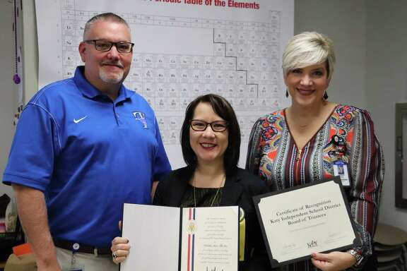 The Katy Independent School District recently presented a certificate of appreciation to Taylor High School teacher Tabitha Vu. From left are Taylor High School Principal Chris Morgan, Vu, and Katy ISD Board of Trustees President Courtney Doyle. Vurecently received the Presidential Award for Excellence in Mathematics and Science Teaching.