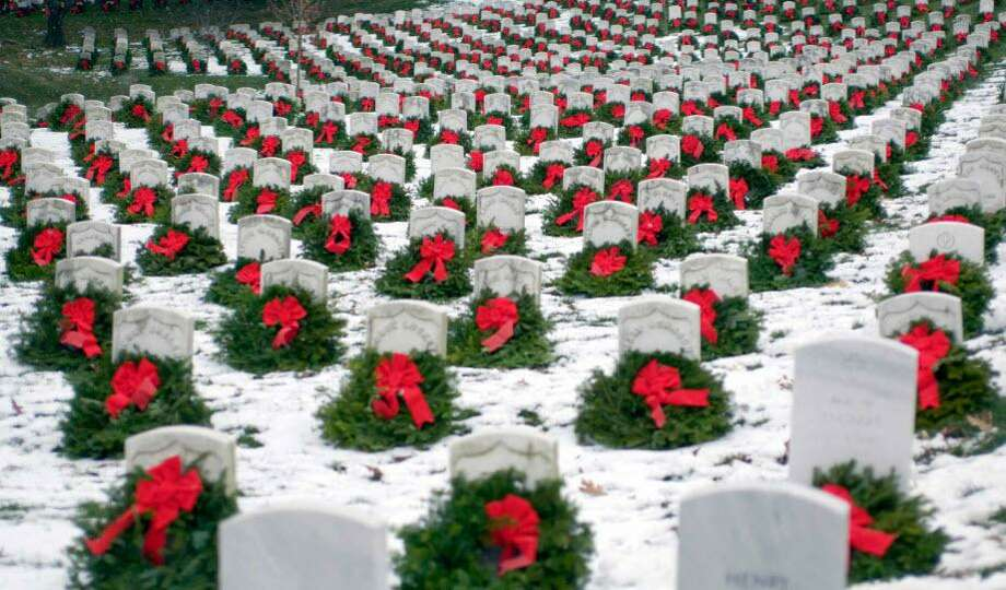 This 2005 photo of the stones at Arlington adorned with wreaths and covered in snow is credited with bringing national attention to the efforts of Morrill Worcester, owner of Worcester Wreath Co.of Maine, who first placed surplus wreaths on graves in 1992. National interest in the annual tribute led to the formation of Wreaths Across America as a non-profit 501-(c)(3). Katy will observe Wreaths Across America at Katy Magnolia Cemetery, 6801 Franz Road, on Saturday, Dec. 14, starting at 10 a.m. Photo: Https://www.wreathsacrossamerica.org/ / Https://www.wreathsacrossamerica.org/