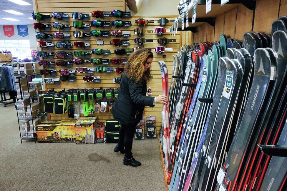 Laura Brothers of Clifton Park looks over some skis as she shopped for ski gear for her daughter, Sophia, at Alpin Haus on Wednesday, Dec. 4, 2019, in Clifton Park, N.Y. (Paul Buckowski/Times Union)