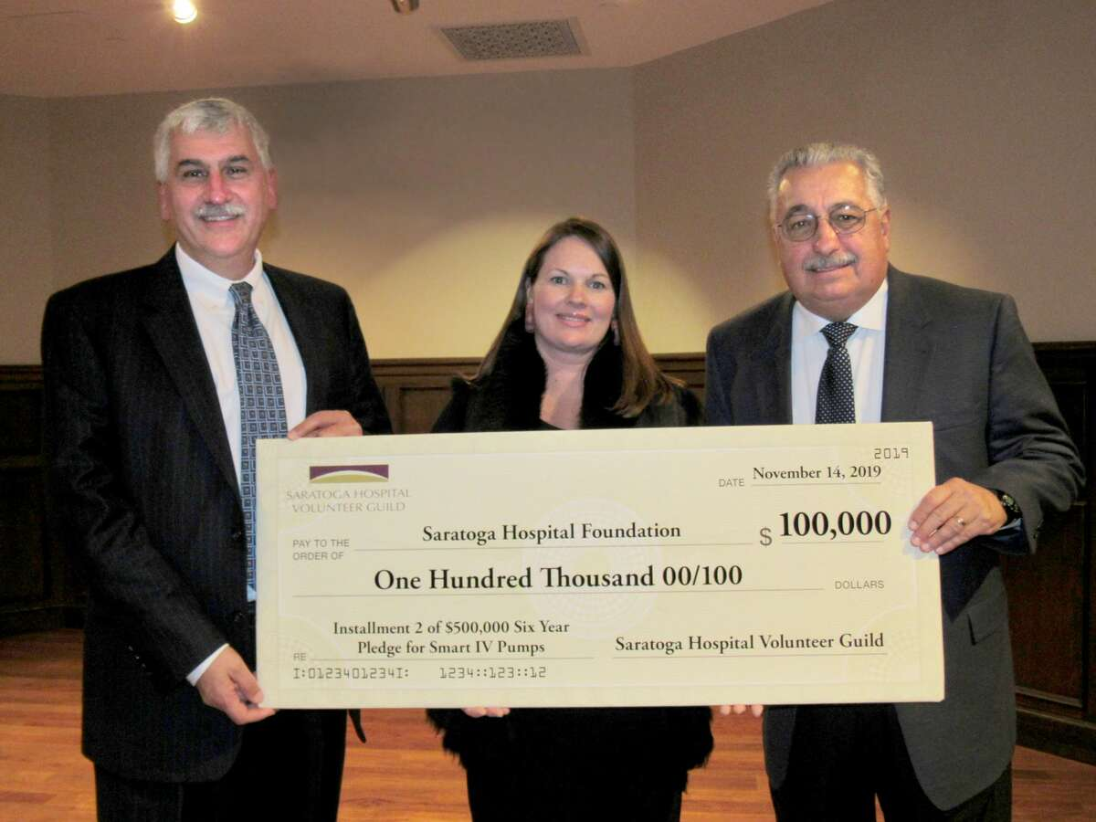 From left, Angelo Calbone, president and CEO of Saratoga Hospital, Meredith Woolford, executive director of Saratoga Hospital Foundation, and Terry White, president of the Saratoga Hospital Volunteer Guild, hold up one of the four checks representing a total of $210,000 the Guild recently donated for vital healthcare services and supplies.