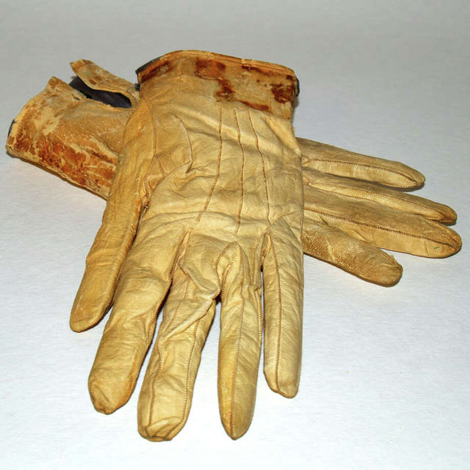 These blood-stained gloves that were in Abraham Lincoln's pocket when he died are among the artifacts the Abraham Lincoln Presidential Library Foundation borrowed $23 million in 2007 to purchase.