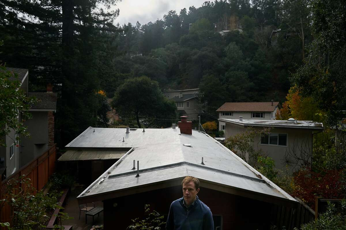 Sean Coffey stands in the back yard of his home on Thursday, Dec. 5, 2019, in Oakland, Calif.