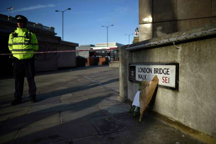 Flowers honor the victims at the site of the recent London Bridge stabbing attack. A reader says the blame doesn't lie with the weapon. Photo: Peter Summers /Getty Images / 2019 Getty Images