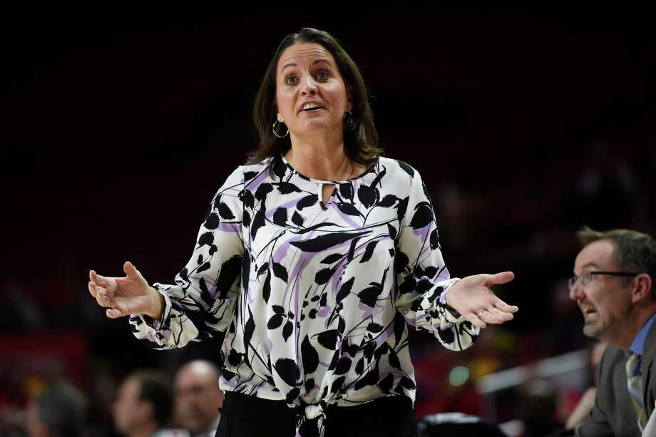 George Washington head coach Jennifer Rizzotti, a UConn graduate who grew up in New Fairfield, instructs her team during the first half against Maryland in November. Photo: Gail Burton / Associated Press / Copyright {2019} The Associated Press. All rights reserved.