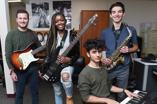 From left, High School in the Community music director Michael McGinley, along with student jazz band members Kaila Bolden on bass guitar, Angel Alvarez on keyboard and Thomas Sabin on the saxophone.